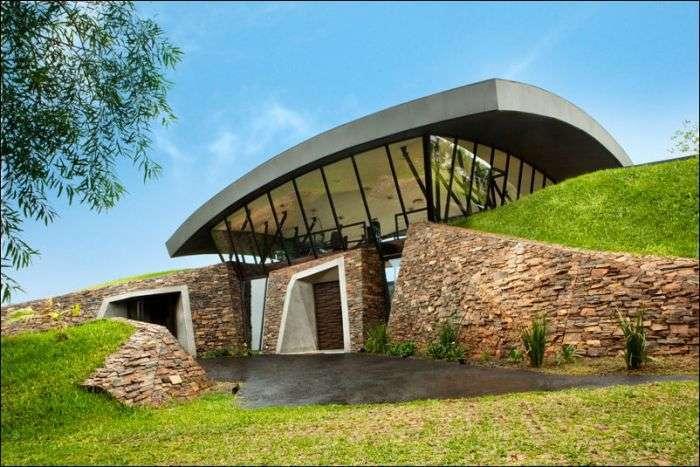 Еко-будинок, спроектований всередині пагорба (14 фото)